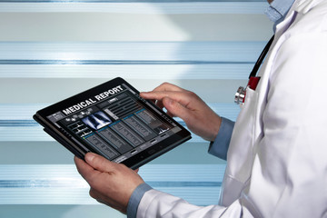 doctor with tablet data consulting a medical report of a patient / practitioner with a medical record health on the screen a digital device