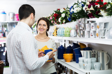 Couple buying ceramic tableware
