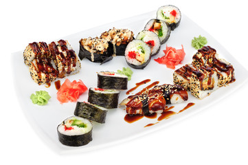 Maki and uramaki sushi set of rolls isolated on white