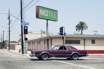 Car passing motel in Los Angeles, California