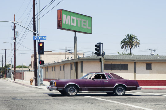 Car passing motel in Los Angeles, California