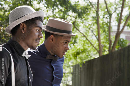 Two young black men dressed in bow ties and hats ba38c5c68255