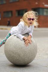 Portrait of a little girl in sunglasses.