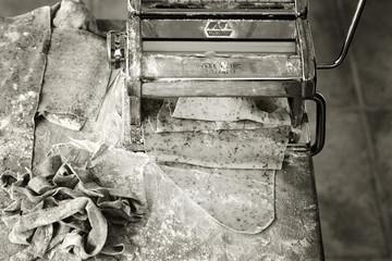 Homemade pasta in machine, black and white