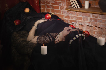 Woman with poisoned apple lies in a tomb