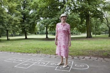 Woman standing on hopscotch markings