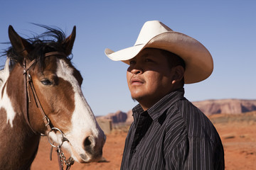 A cowboy and horse, Monument Valley Navajo Tribal Park, Monument Valley, Utah, USA