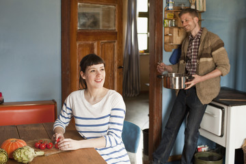 A couple cooking in a domestic kitchen