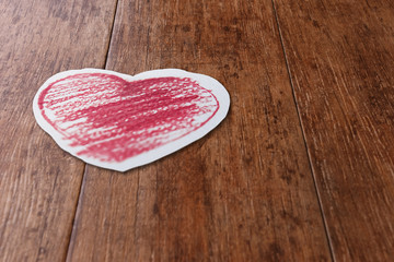 Red Heart Draw on Paper Wooden Floor