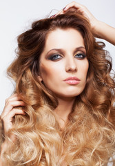 Portrait of young beautiful woman with curly shaggy hair style