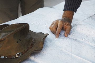 A hand pointing on a map, Namibia