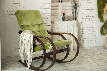 Green rocking chair on a background