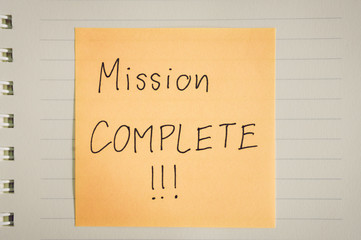 Mission complete words on paper