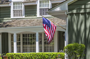 American flag in front of typical american house