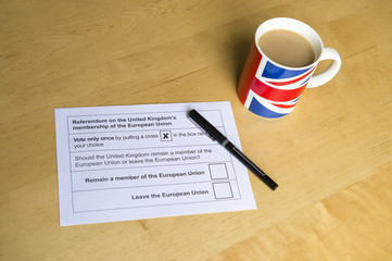 Voting ballot for the referendum on the United Kingdom's membership of the European Union leave or remain campaign next to a cup of tea in a  Union Jack mug