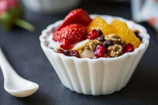 Granola with Orange,Strawberry on yogurt