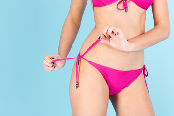 Cropped image of a womens body wearing bikini