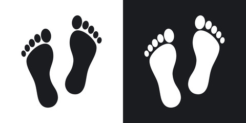 Human footprints icon. Two-tone version on black and white background
