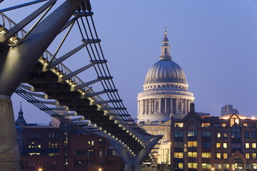 Millennium Bridge and St. Pauls Cathedral, illuminated at dusk, London, England, United Kingdom, Europe