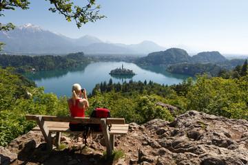 Tourist making photo of lake Bled, Slovenia