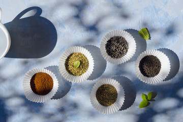 Grounded coffee and different types of teas: green, black, mint and herbal