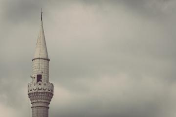 minaret on cloudy sky