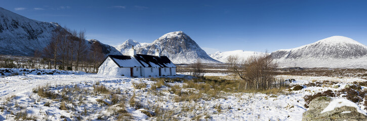 Panoramic view of Black Rock Cottage with Buachaille Etive Mor in distance on snow covered Rannoch Moor, near Fort William, Highland, Scotland, United Kingdom, Europe