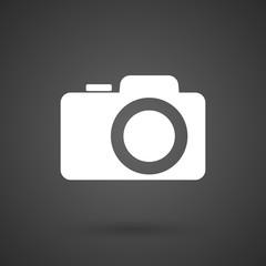 a photo camera    white icon on a dark  background