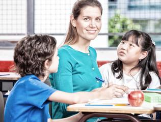 Beautiful teacher with mixed race classroom