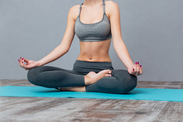 Cropped image of a young beautiful girl practicing yoga
