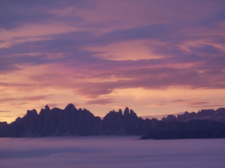 Tranquil view of purple clouds and mountains