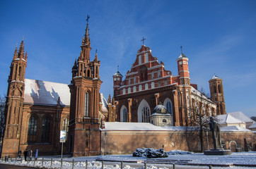 St. Anne's Church and the church of the Bernardine Monastery under snow in Vilnius, Lithuania. Wall mural
