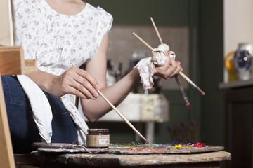 Female artist using palette, close-up