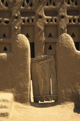 Primative wooden gate at entrance to a Mali, West Africa mosque