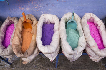 Africa, North Africa, Morocco, Chechaouen,containers of colorful pigments,powders or dyes on historical village street.