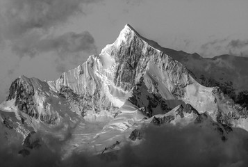 Snow-capped mountain peak at sunrise