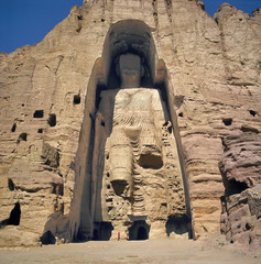 Afghanistan, Bamian Valley. A person stands at the base of the Great Buddha in the Bamian Valley, a World Heritage Site, in Afghanistan.