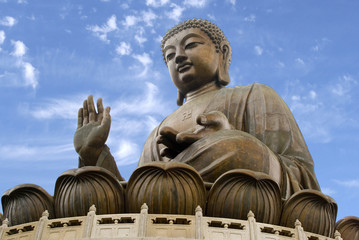 The giant bronze Tian Tan Buddha statue sits on a lotus throne