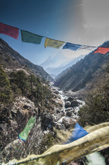 Prayer flags from bridge with Mt.Ama Dablam in background