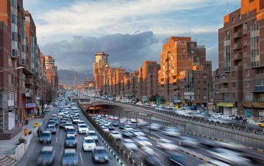 Tehran Cityscape with Sunlit Navvab Buildings and Cars Passing Through Tohid Tunnel