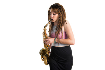 Girl with dreadlocks playing the saxophone