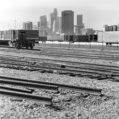 Train tracks, cargo containers and skyscrapers in Los Angeles, California, USA