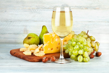 Wineglass white wine with fruits nut