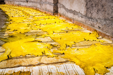 Yellow tinted leather drying in the sun in a tannery in Fez, Morocco