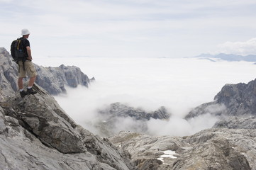 Hiker on Tesorero Peak, Picos de Europa National Park, shared by the provinces of Asturias, Cantabria and Leon, Spain, Europe