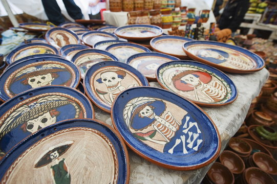 Skeleton pattern on ceramics for sale in the market during Day of the Dead festival, Patzcuaro, Michoacan state, Mexico