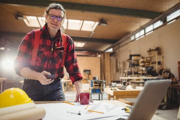Carpenter using his smartphone