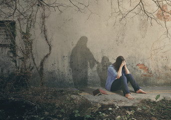 Shadow of Jesus comforts a woman