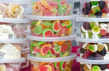 Candy in plastic containers on the market