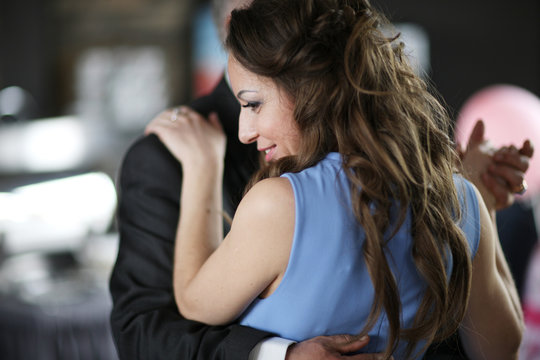 Joyful woman dancing with a partner